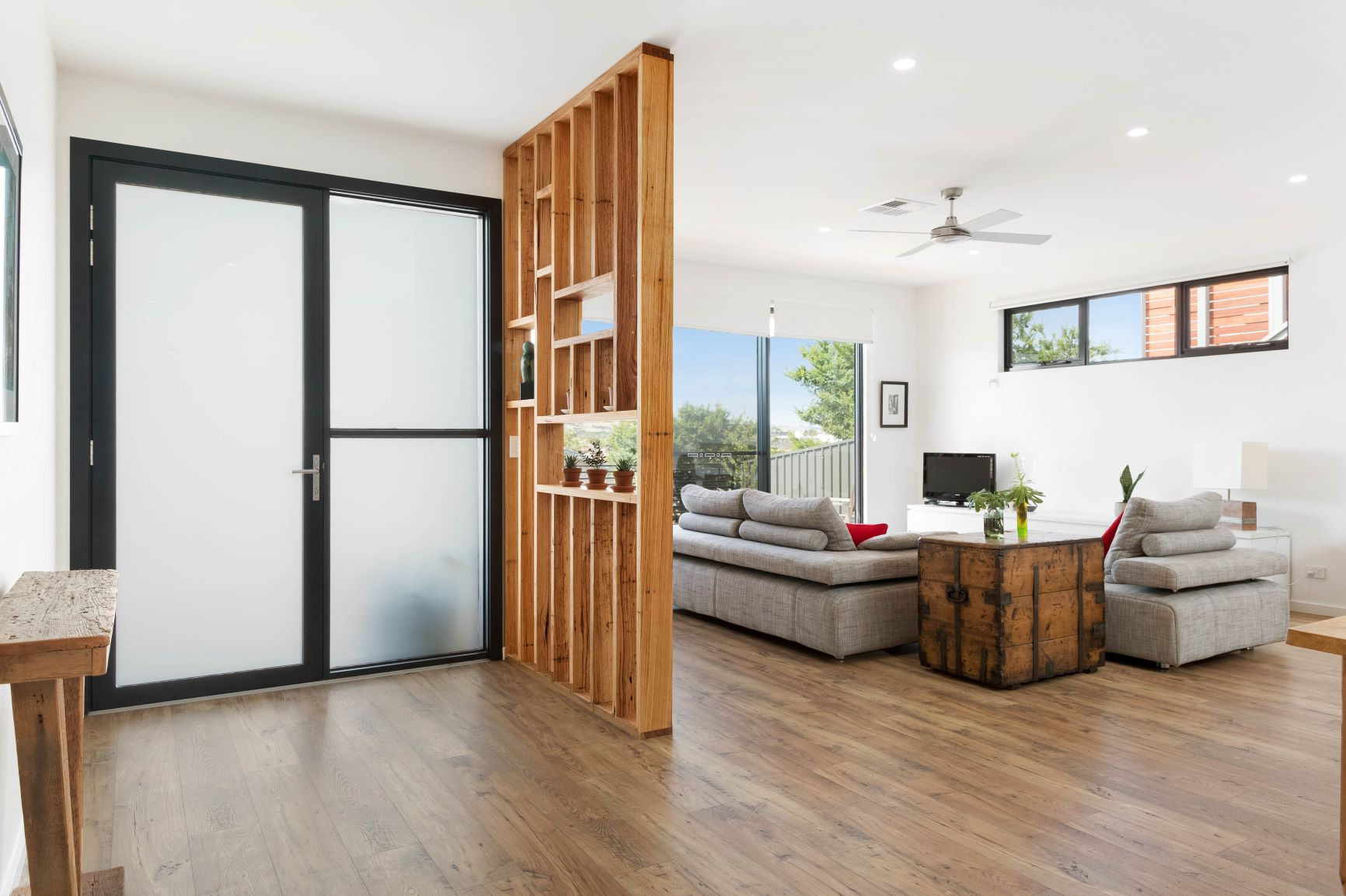 Custom Home, New Home, Single Storey Home, Builders, Design, Port Elliot, Fleurieu, Living Area, Feature Wall, Frosted Glass Door, Laminated Floor